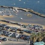 """Marina di Palmi, la spiaggia diventa parcheggio. Il sindaco: """"Via le auto"""""""